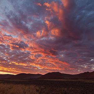 Burning Sky, Sunset at Sossusvlei Sand Dunes, Namib Desert, Namibia Naukluft Park, Namibia, Africa