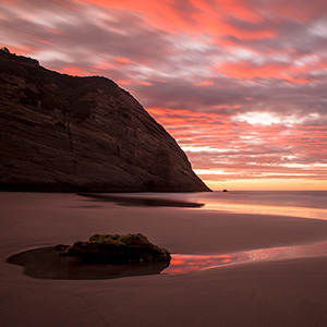 Wharariki Beach Sunset with Purple Clouds and Sky, South Pacific Ocean, New Zealand