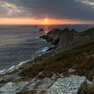 Bretagne Sunset at the Pointe du Raz with beautiful dramatic sky and Lighthouse, France