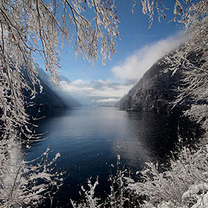 Winterdream - beautiful Koenigssee Malerwinkel with sun and snow, Alps Mountains, Bavaria, Germany