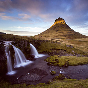 The Rock - Kirkjufell mountain with Kirkjufellsvoss waterfalls in the front at sunset, Iceland