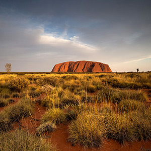 Uluru, Ayers Rock with clouds in the Outback Desert, Northern Territory, Australia