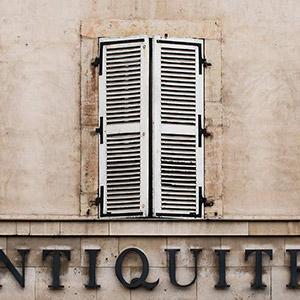 Antiquites shop in a classical stone building in Strasbourg, Alsace, France