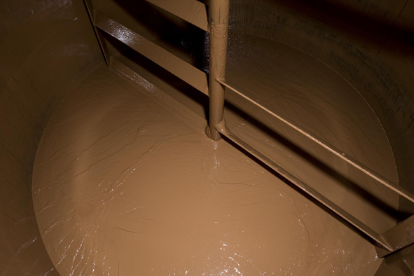 The chocolate is stored in big tanks at about 40 degrees Celsius until it gets pumped one floor up in order to be poured.