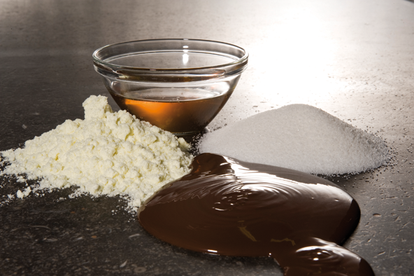 Chocolate consists of the basic ingredients cacao mass, cacao butter, sugar, and milk powder.