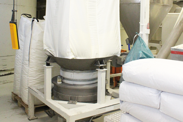 The milk powder is supplied in enormous bags. The cacao mass, cacao butter, and sugar are added through a pipe system.