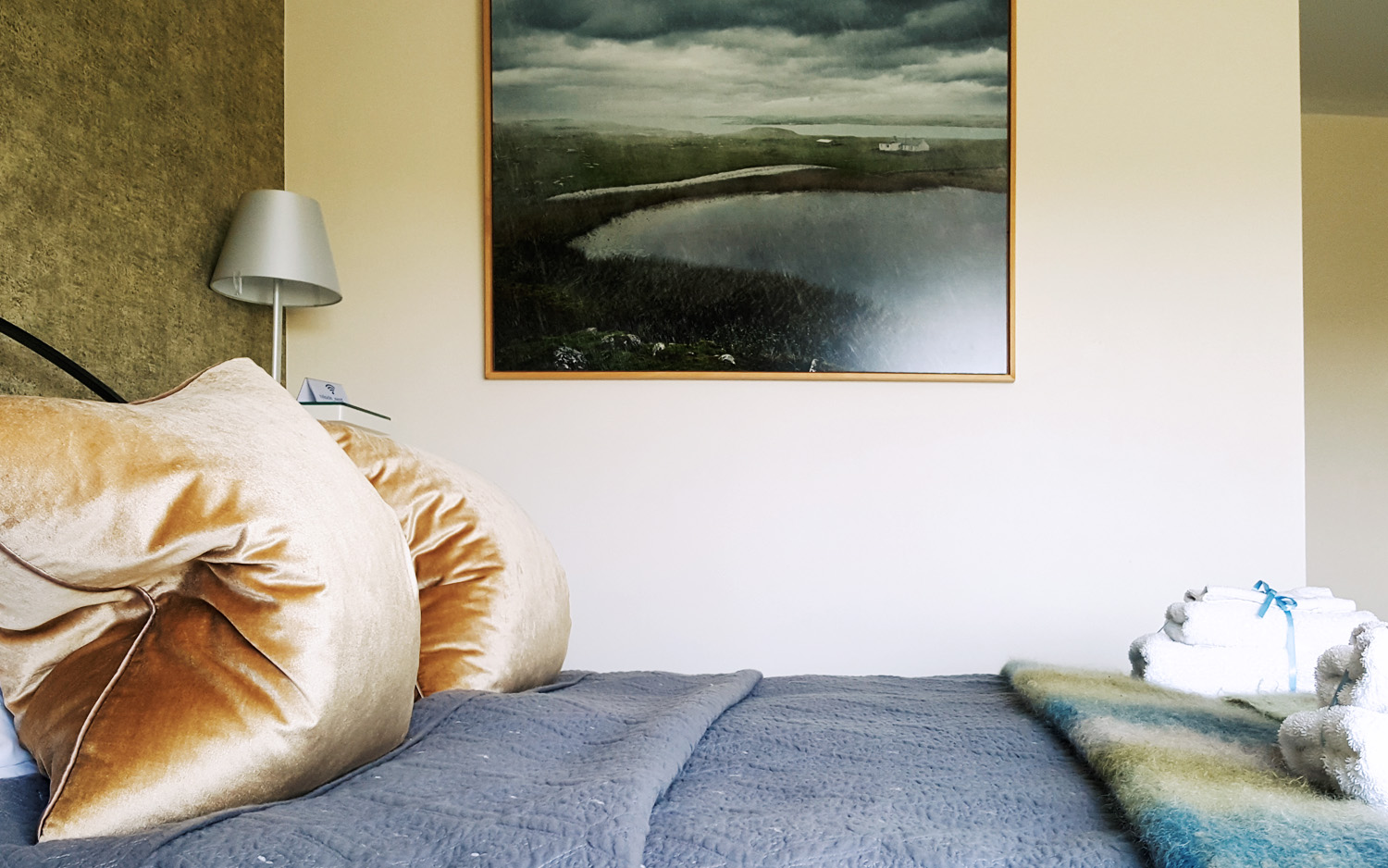 Omey island photograph, chic bedspread and throw in Connemara colours, beautiful bedroom