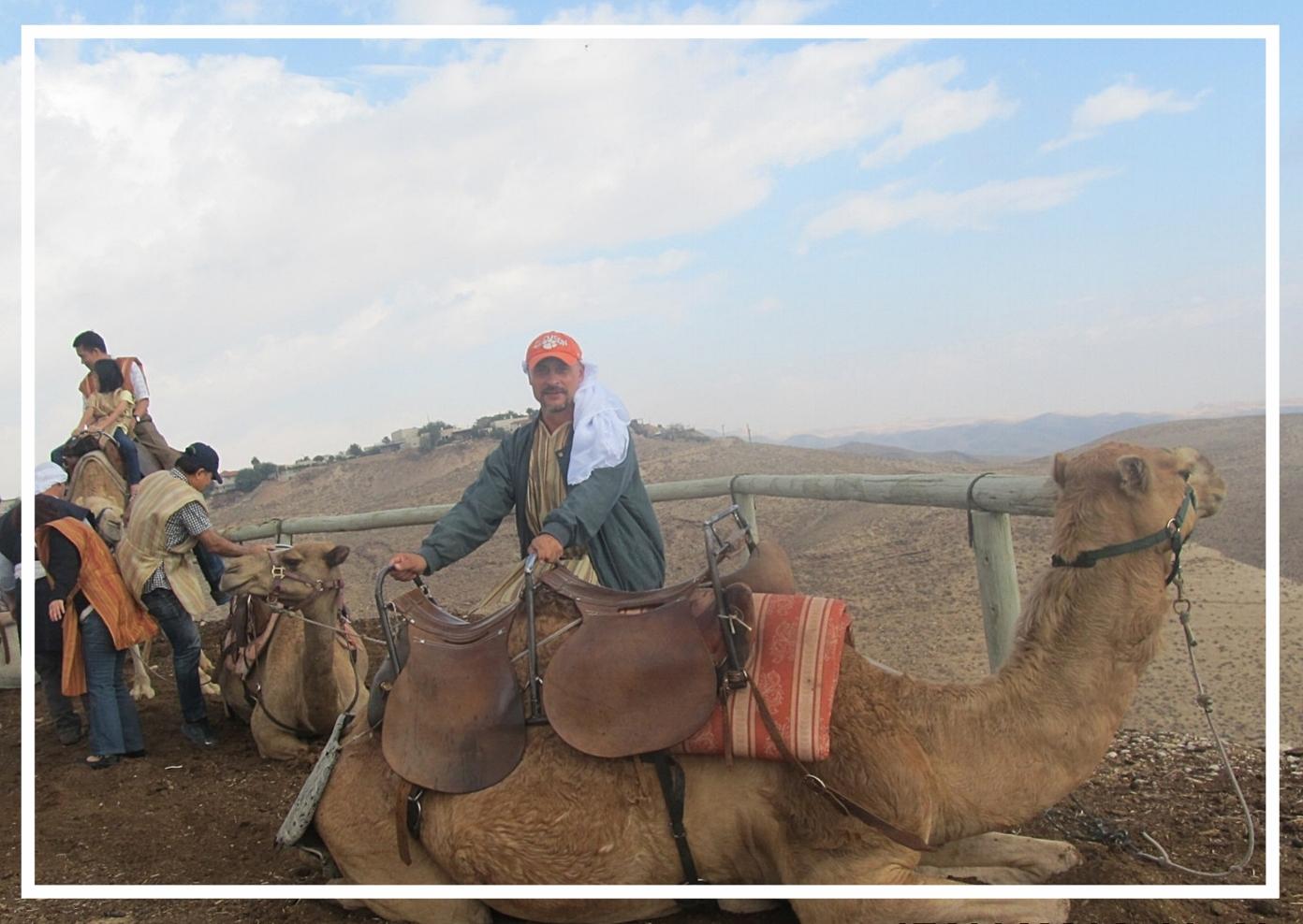 Camel ride in the desert, 2014