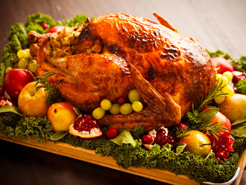 Fill yourself up on high-protein foods (like turkey and ham) and fiber-rich fruit and vegetables