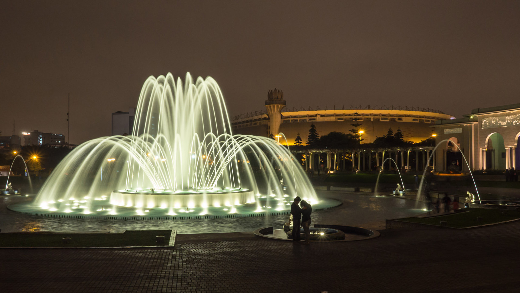 "Lima: Reserve Park with 13 fountains, ""Magic Fountain"" and National stadium in the background"