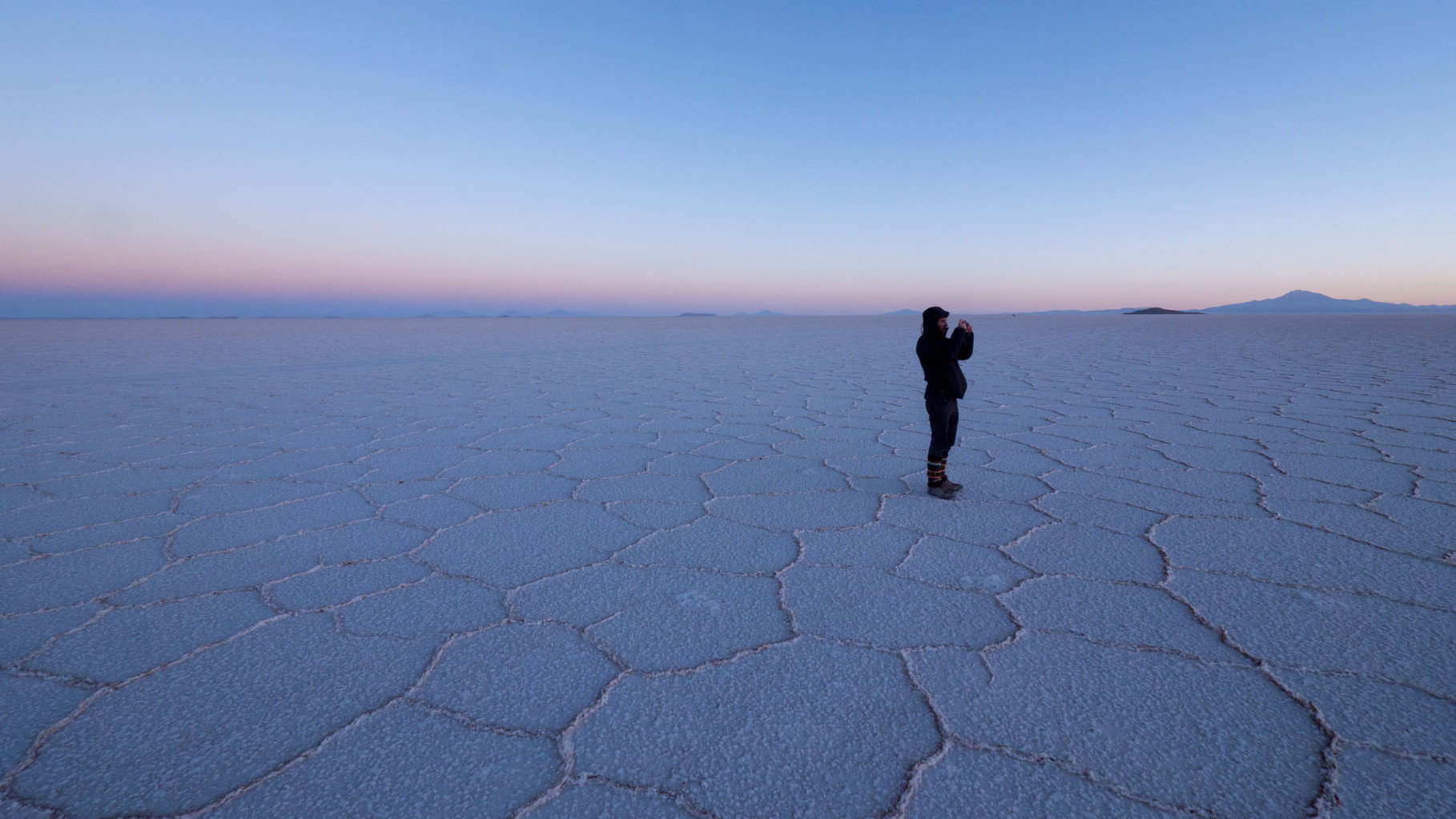 Sunrise at Salar de Uyuni (biggest salt lake in the world, around 2000 sqkm)