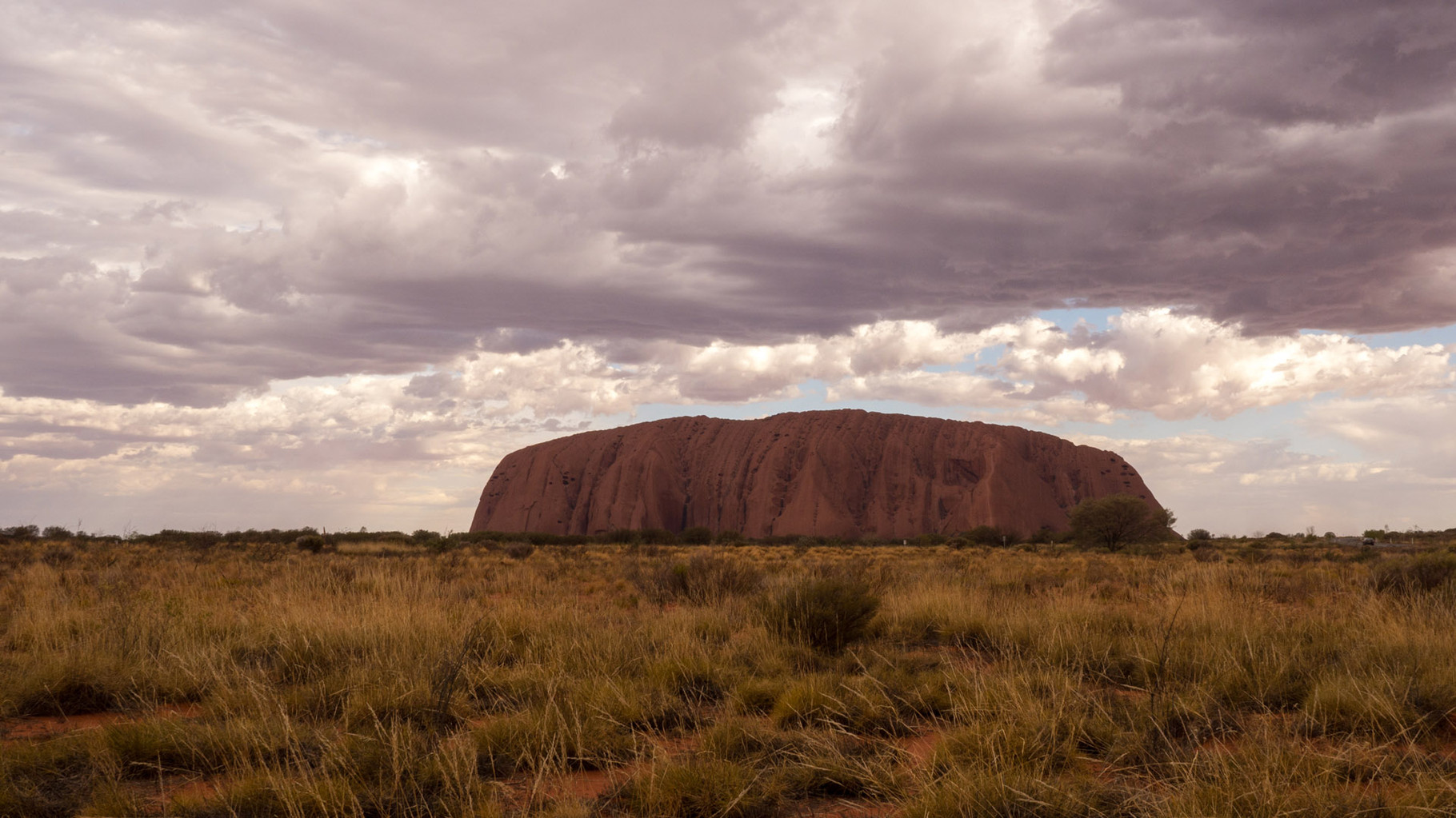 Uluru (Ayers Rock) at a cloudy late afternoon