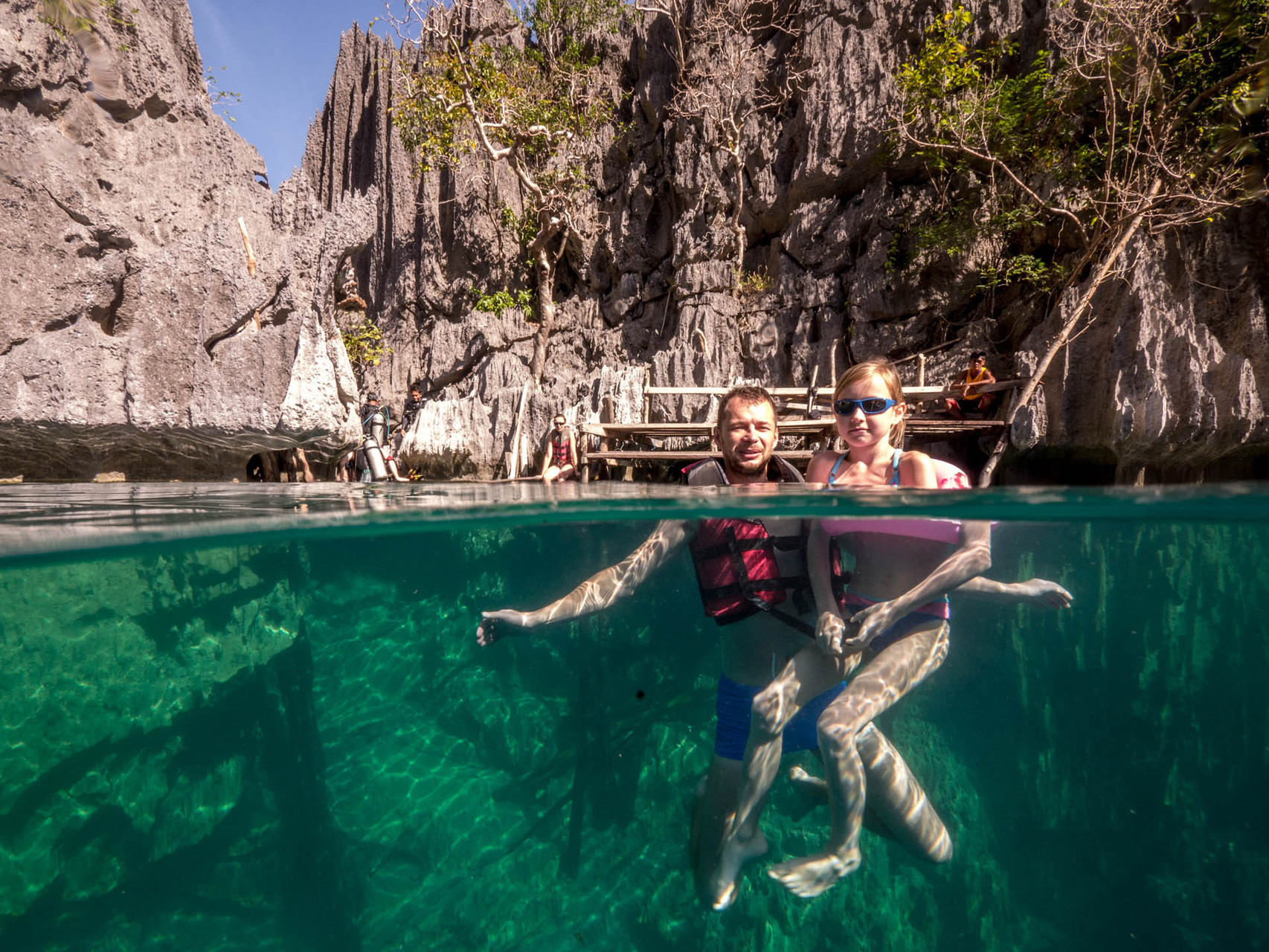 Half-half picture of swimmers in the Baracuda lake, Coron