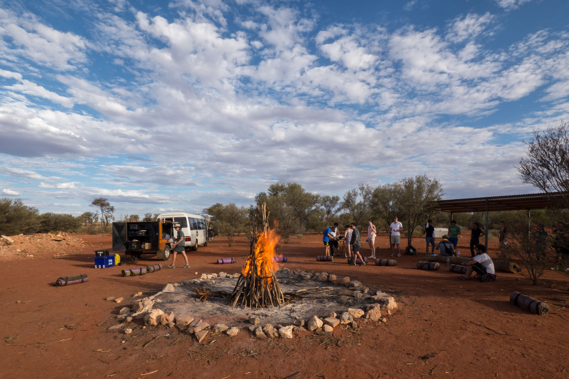 Campfire and camping in the bush, near Uluru