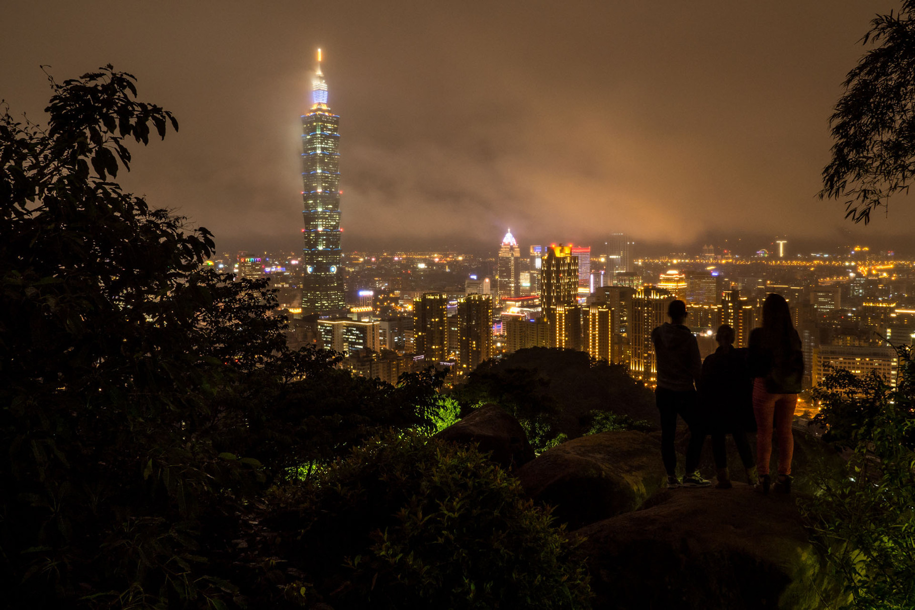 Taipei and the iconic Taipei101 tower during a cloudy night, photographed from the Elephant mountain