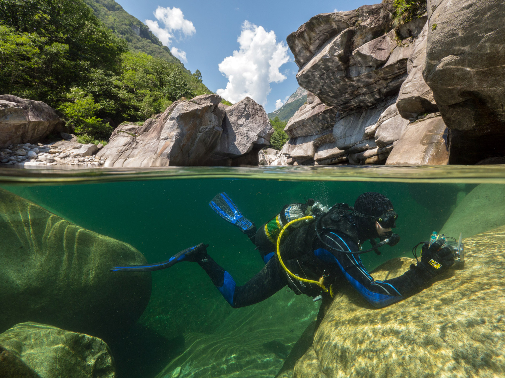 River diving in the crystal clear waters of Verzsasca
