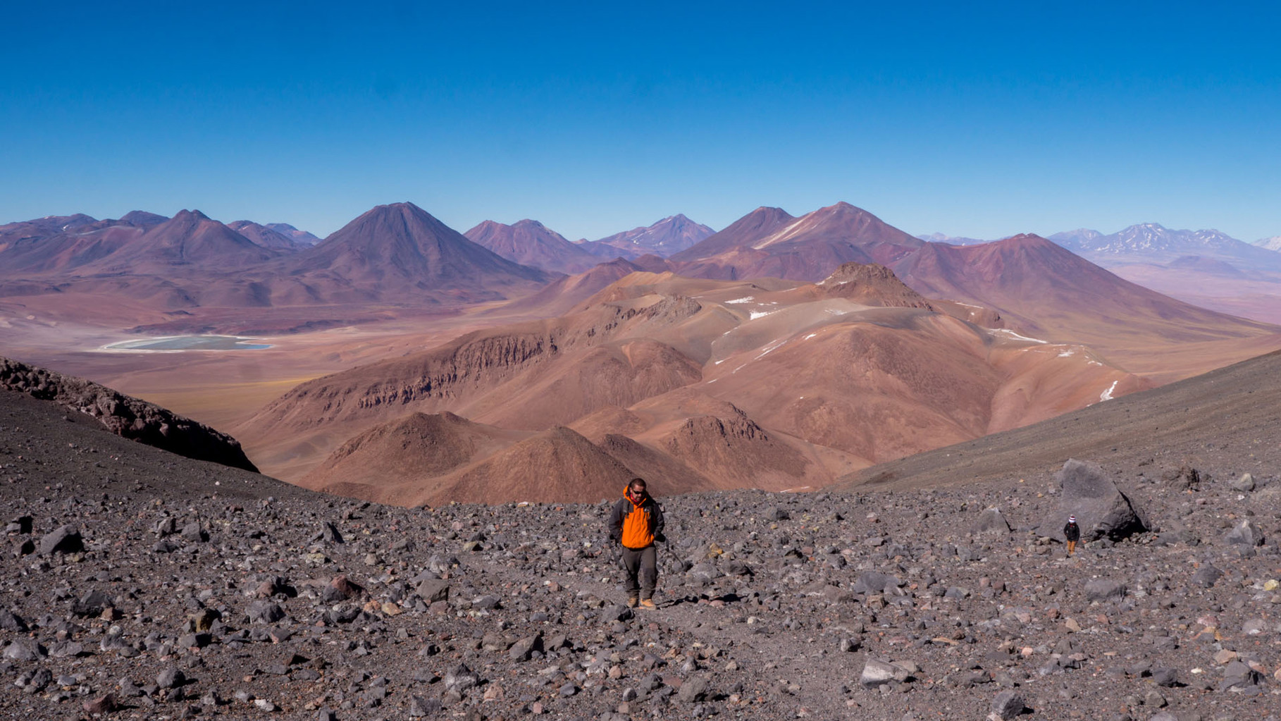 Ascending activ volcano Lascar (5600masl), Andes and Laguna Lejio in the background, near San Pedro de Atacama, Chile