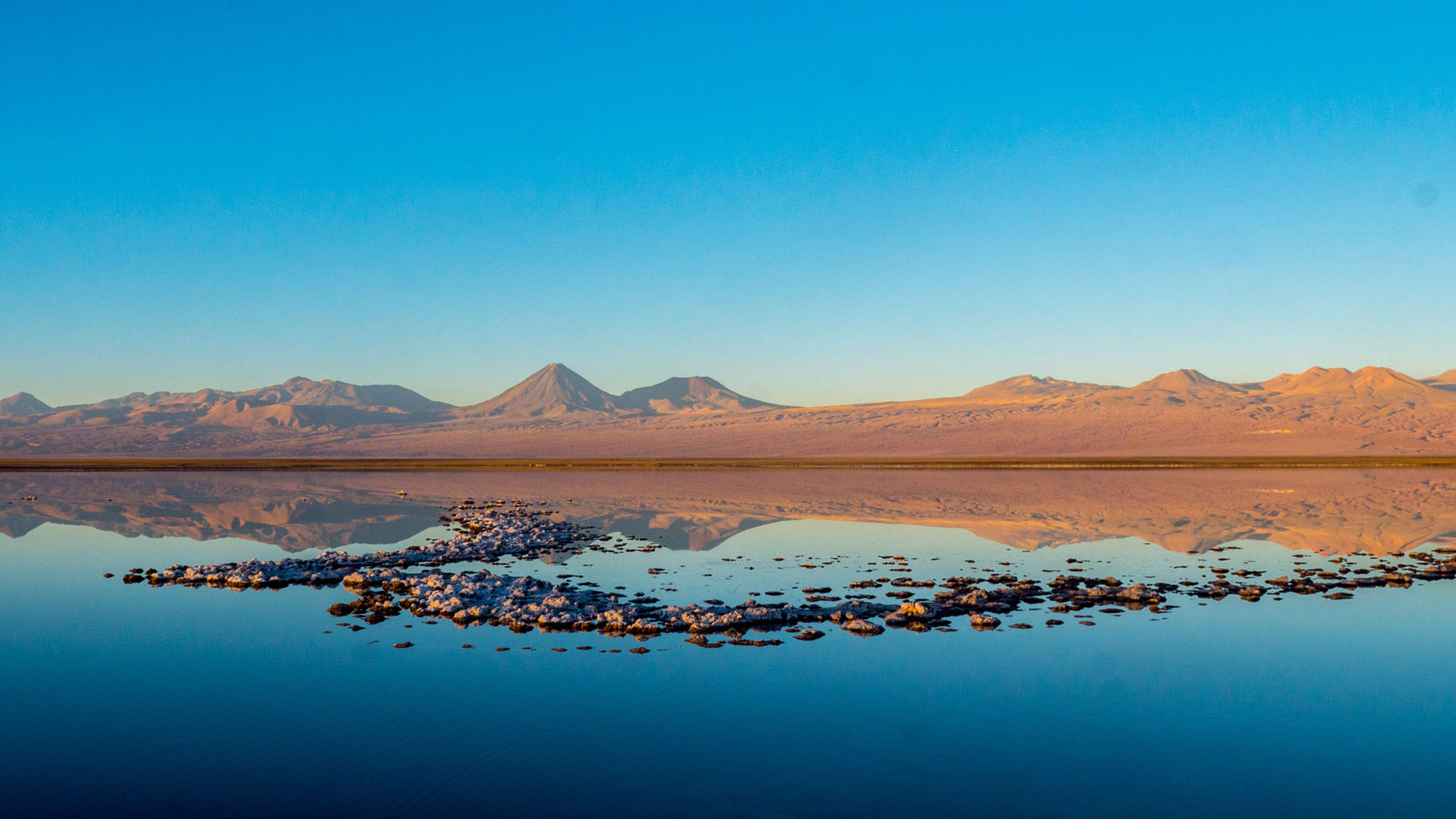 Sunset at Laguna Tebenquiche, reflections of Andes, near San Pedro de Atacama, Chile