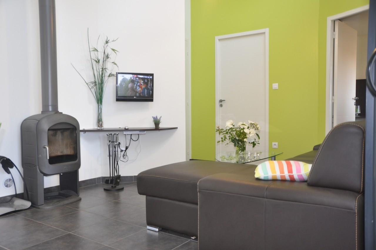 Le salon est équipé d'un téléviseur écran plat