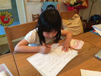 Y-chan crafting her reply to her pen pals excitedly