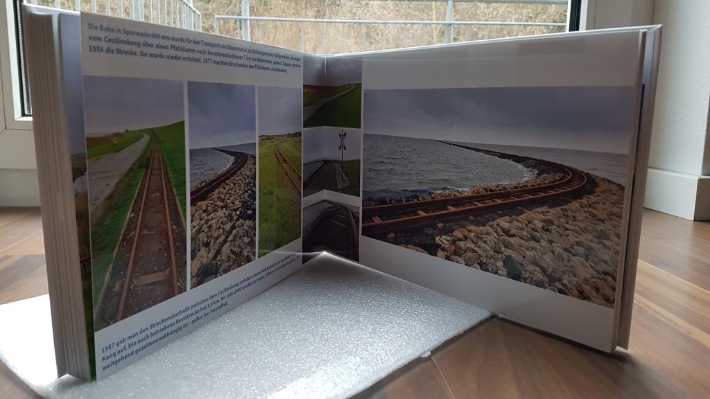 Bilder in den verschiedensten Größen kommen auf glänzenden Seiten sehr plastisch heraus.