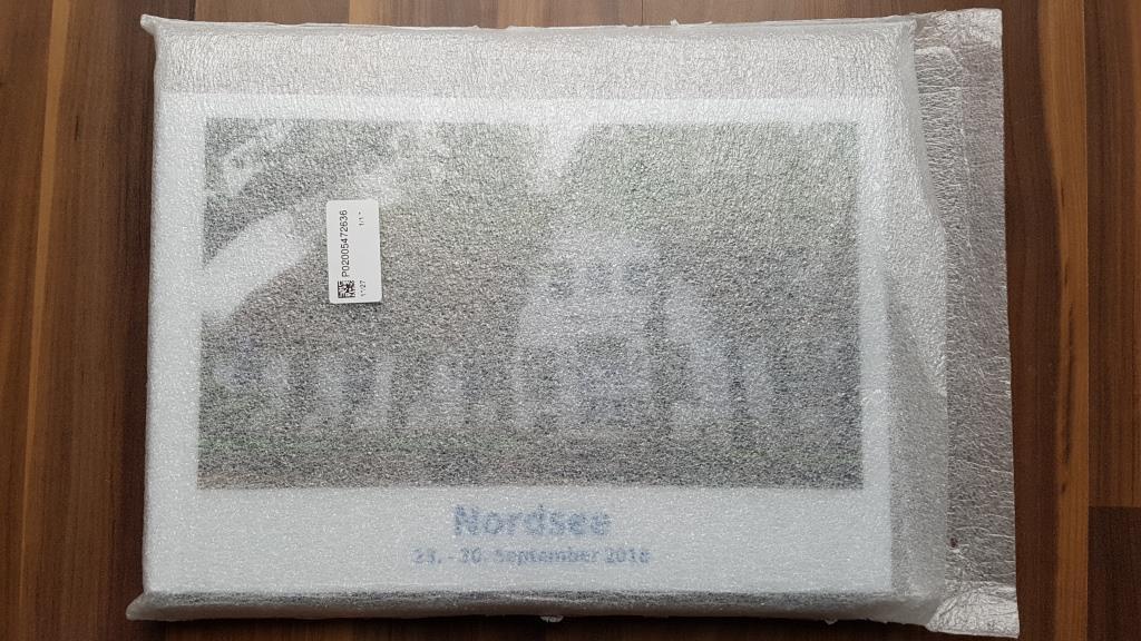 In der Verpackungskartonage ist das Fotobuch nochmal mit einer separaten Hülle geschützt.