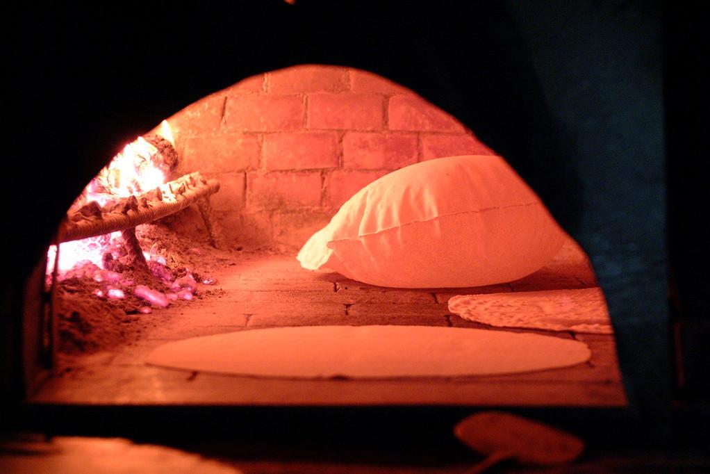 Making typical Sardinian bread, the Carasau