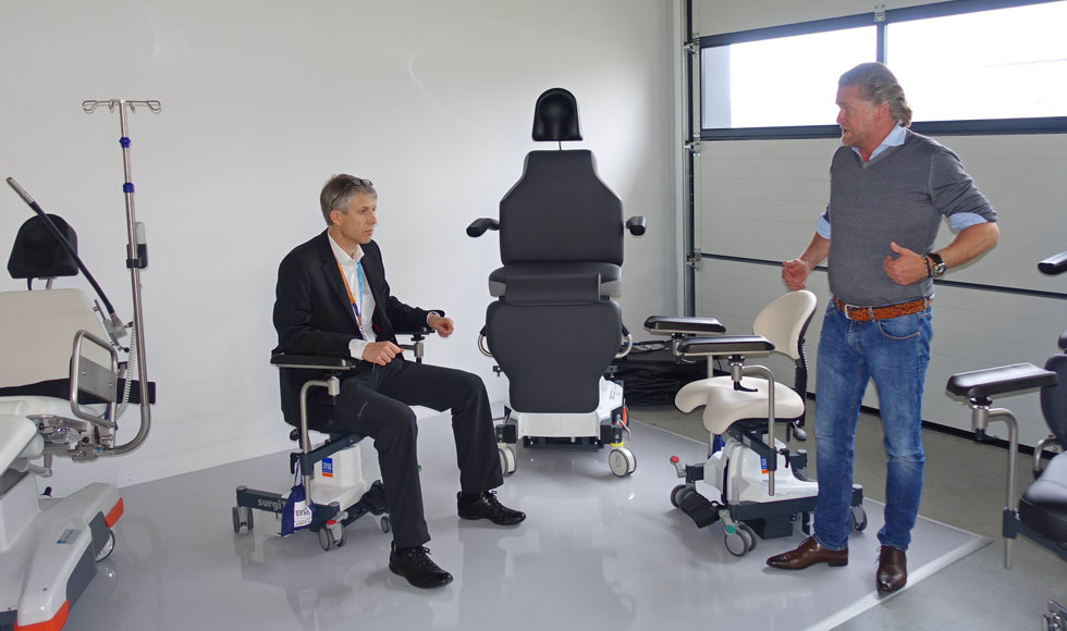 Werner is testing the new surgeon's chair in the company of Mr. Scherrieble (right in the picture).
