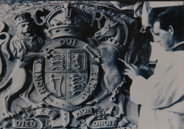 (DR) John Grant applying the finishing touches to the Royal Coat of Arms for the Preston Court House in Melbourne. Photo: Courtesy Dr Lachlan Grant
