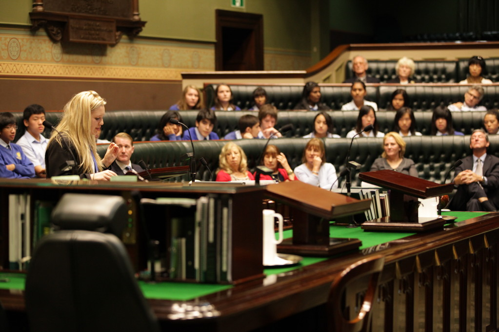 The audience in the Legislative Assembly weigh up the arguments put by both teams