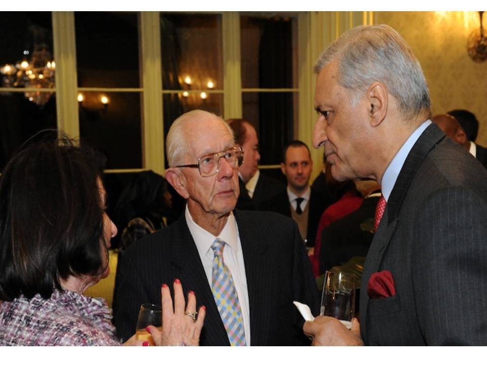 Frank Garland (left) discusses a point of view with Mr Kamalesh Sharma Secretary-General of the Commonwealth