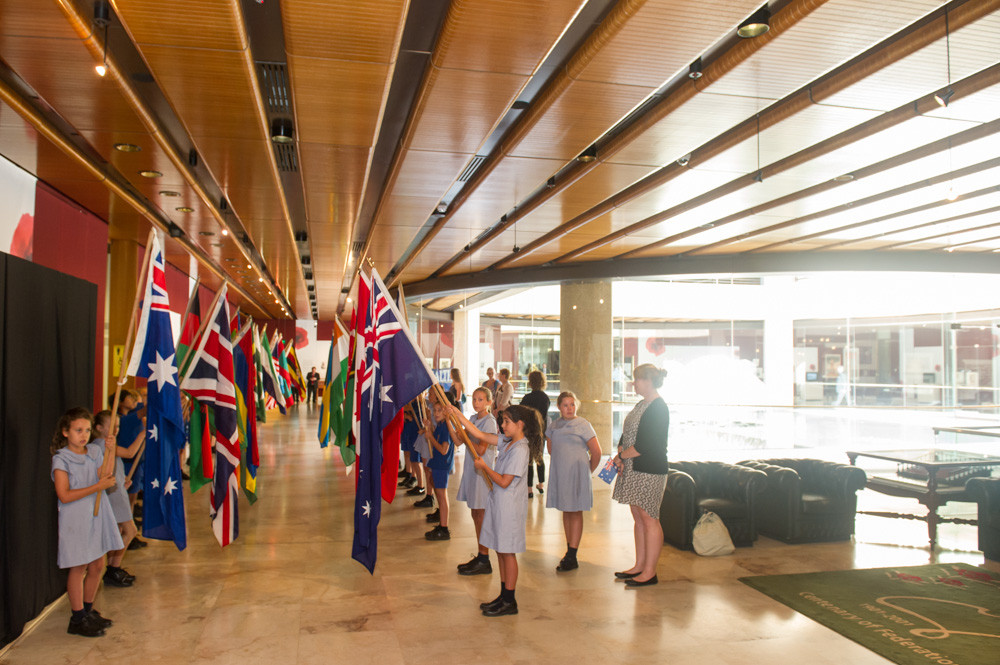 Students from Greenwich Public School with the flags from the 54 Commonwealth of Nations