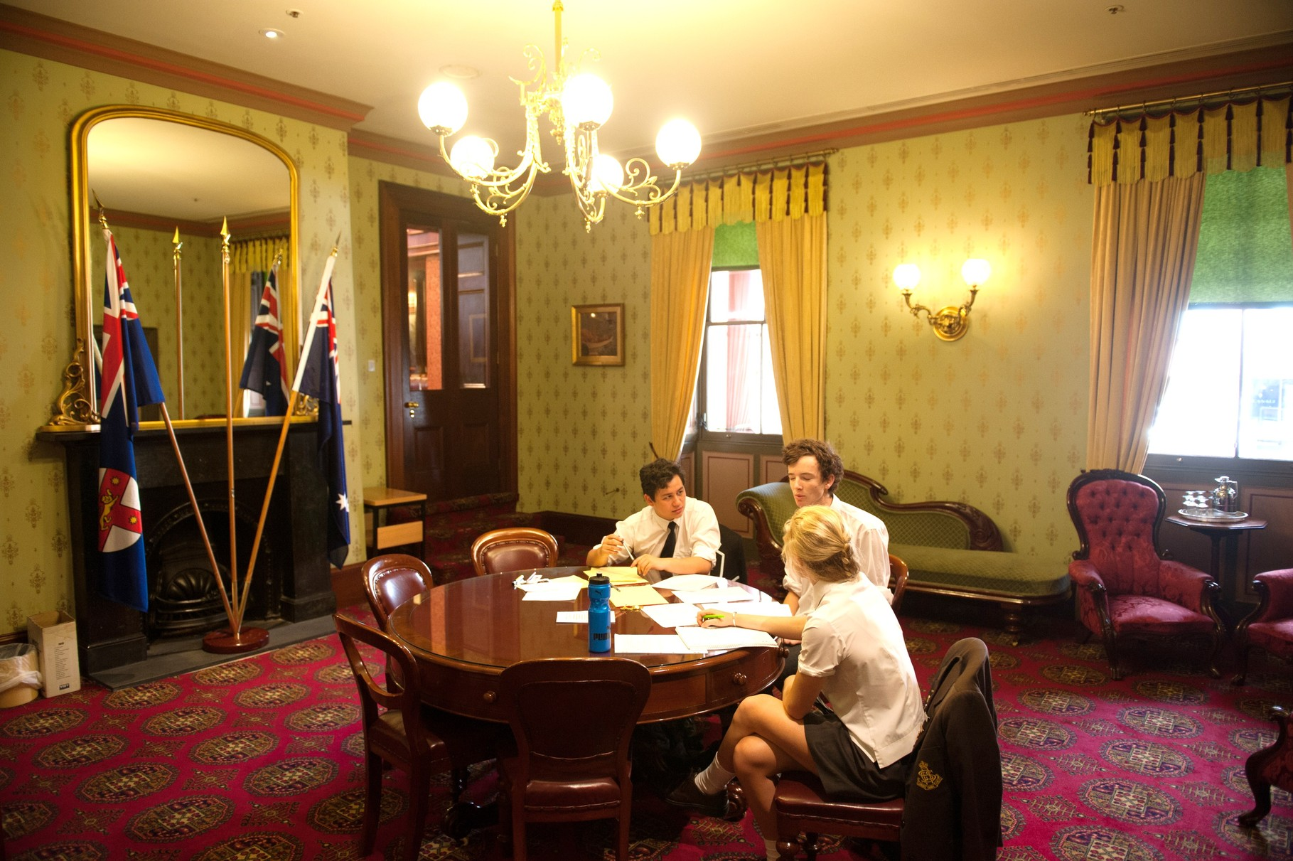 Teams working on their case for the debate in NSW Parliament on Commonwealth Day