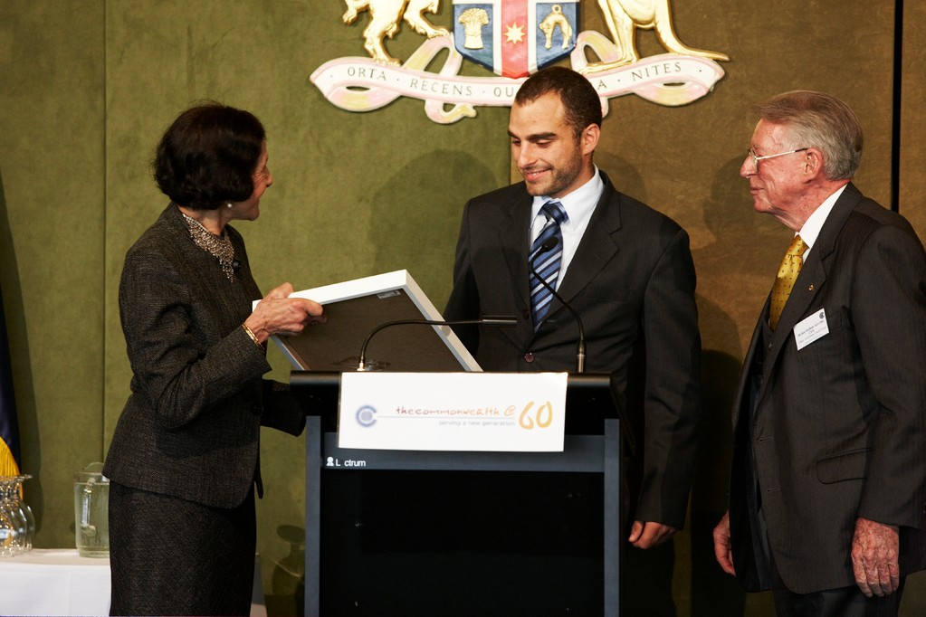 Clary Castrission receiving the Tom Harvey Award in 2009