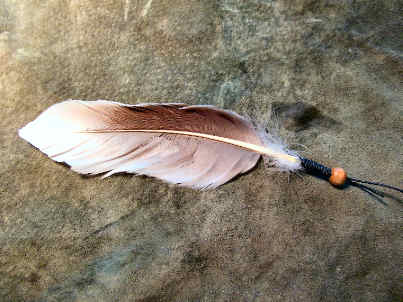 a wrapped feather ready to tie onto your drum or anywhere