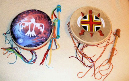 two decorated and painted Hummingbird Drums for a husband and wife