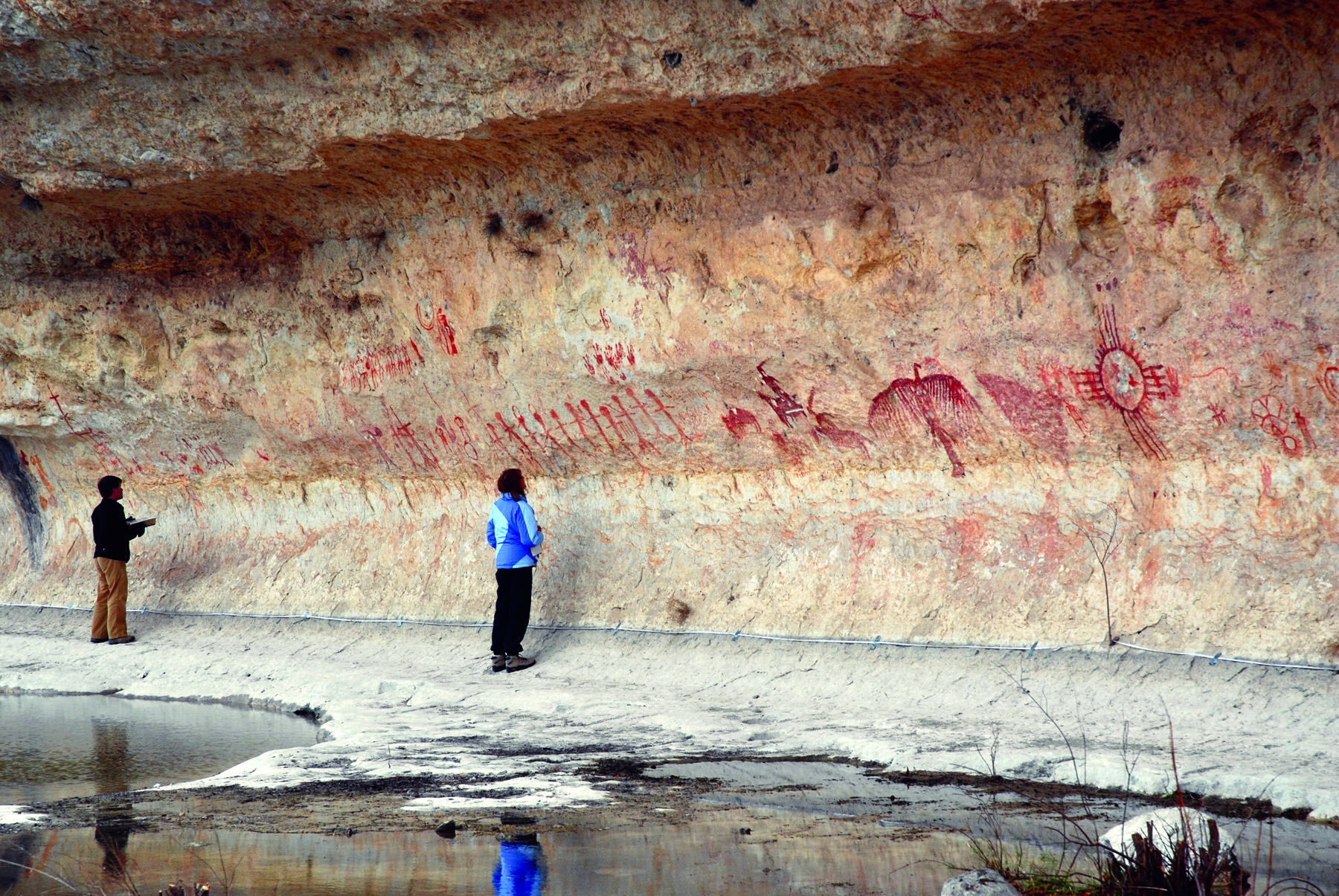 Dr Jamie Hampson studies rock art. These painting in west Texas range from c. 4,000 years old to the nineteenth century.