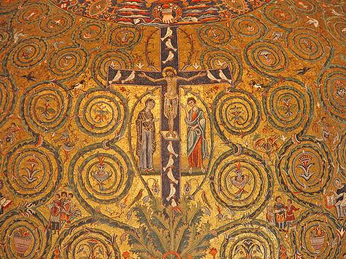 Mosaico absidal SXII Basílica sup. de San Clemente en Roma. El simbolismo del árbol asociado a la tradición de la Cruz, de su base sale una mata de hojas de acanto que da origen a espirales que ocupan la semiesfera, a sus pies los 4 rios del Paraiso.