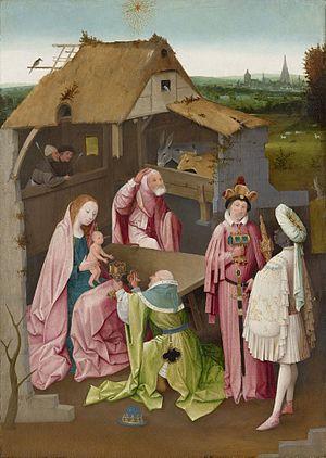 La Virgen sentada en la mesa con el Niño mientras uno de los Magos le ofrece un presente.San José sorprendido se quita la capucha.Llama la atención la riquísima manga del rey negro con la prefiguración d la Eucaristia.