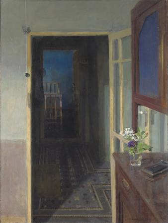 La cocina de Tomelloso 1972 de Maria Moreno, ilumina la habitación en la que se encuentra, su mirada se dirige más allá de la puerta, en la penumbra.Esa combinación de umbral y sombra produce cierto aire de misterio.