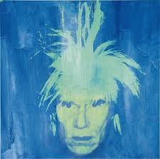 Andy Warhol,Autorretrato con luz negra,1986.Pintura polímera sintética, serigrafia y pintura fluorescente sobre lienzo con preparación.102x102cm.Col Würth.