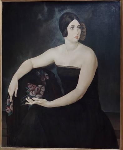 Ubaldo Oppi.Retrato de la esposa 1924.Coleccion Mita y Gigi Tartaglino,Turín.Realidad familiar de rasgos antiguos y solemnes,un aura de absorto misterio rodea a la dama.
