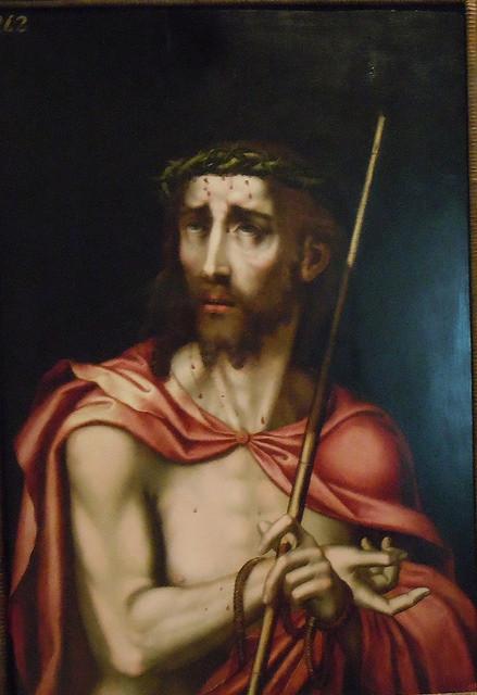 """Ecce Homo,1560/70.Tabla d roble.M.Prado.El tono pálido de su cuerpo resalta con la túnica roja,parece una imagen burlesca de su condición real.Pilatos dijo """"Ecce homo""""He aquí el hombre""""(Jn 19,5)"""