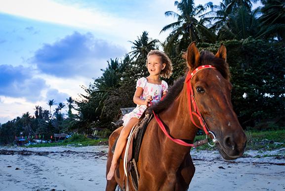Kind Pferd Karibik