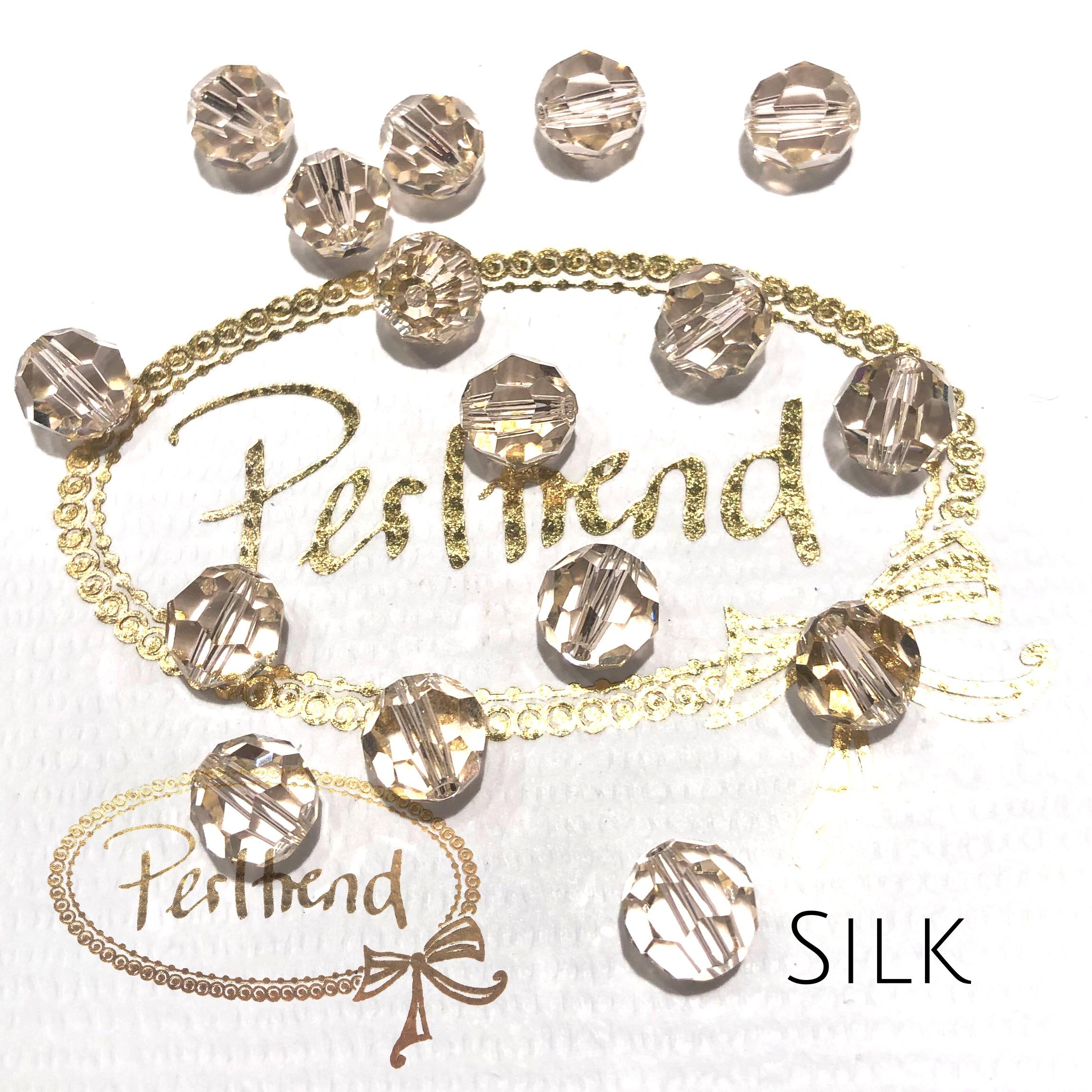 www.perltrend.com Perltrend Luzern Schweiz Onlineshop Perlen Schmuck Accessoires original Swarovski Crystals Crystal facet bead facettiert rund Silk Seide sehr helles apricot beige transparent