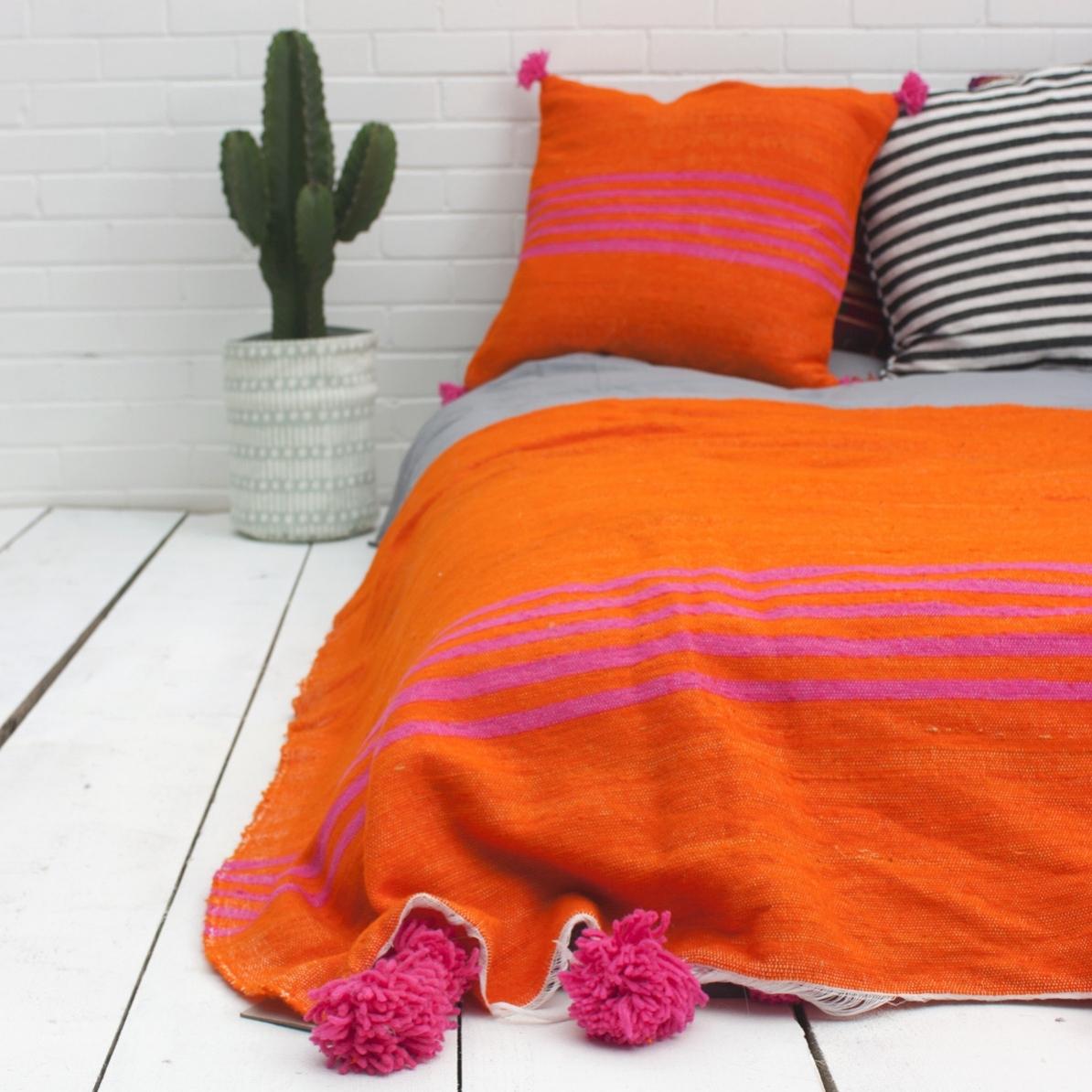 Wollplaids in sonnig warmem Orange mit Pink