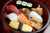 vinegared rice balls with slices of raw fish on top