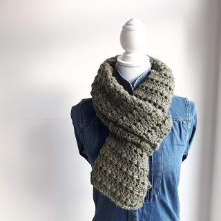 Parel in het Groen sjaal