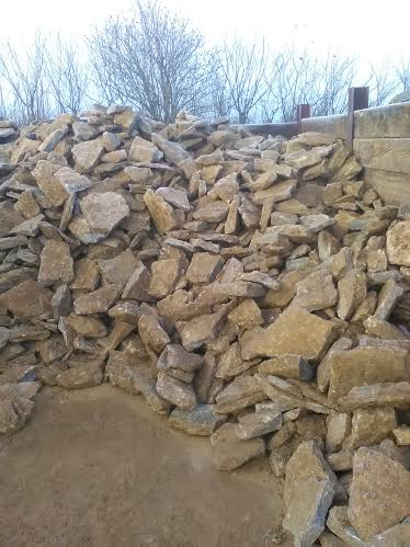 Drystone walling in winter waiting to be loaded - easy to build - flat stone with good faces