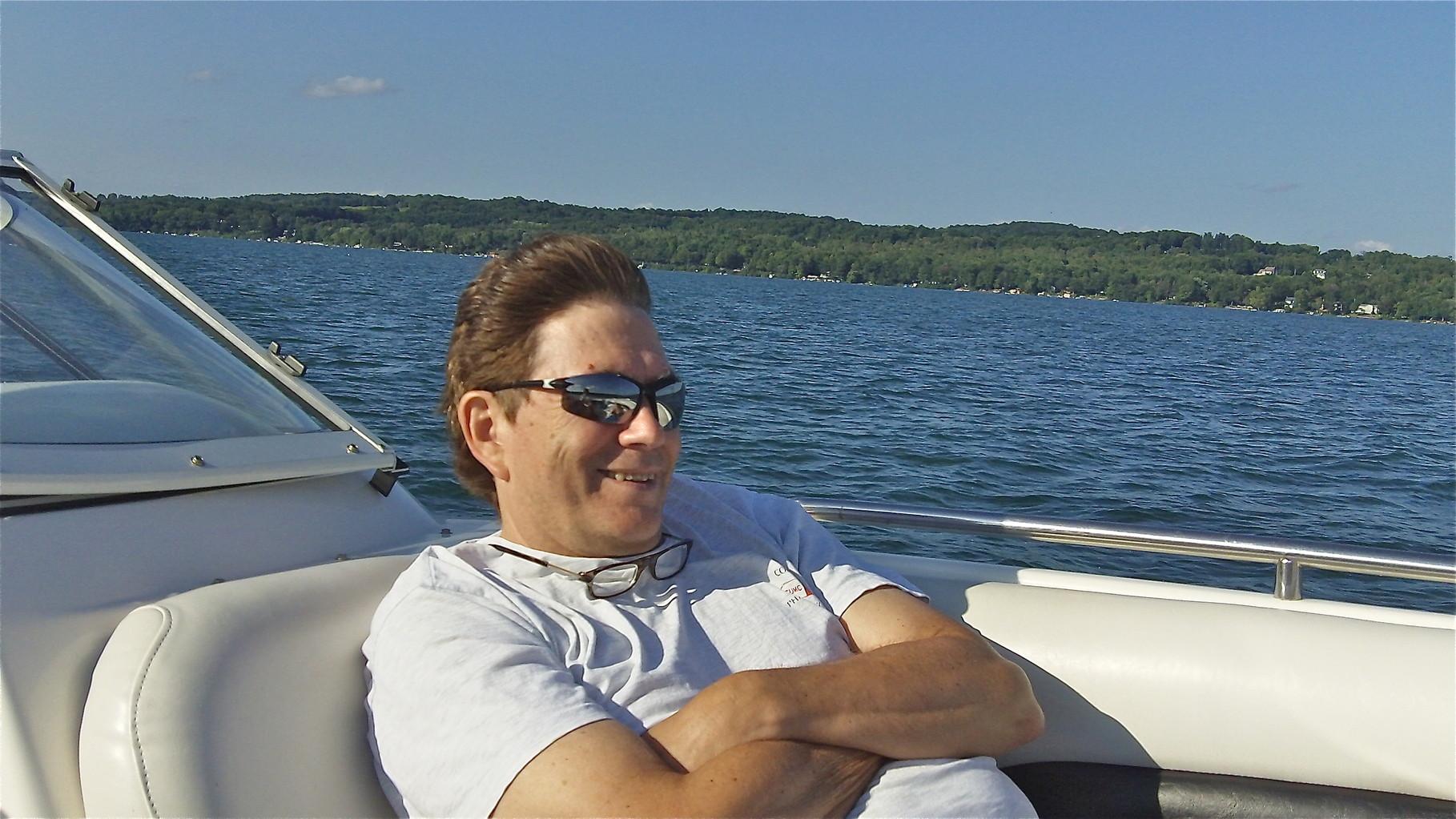 John enjoys the speed on the boat...